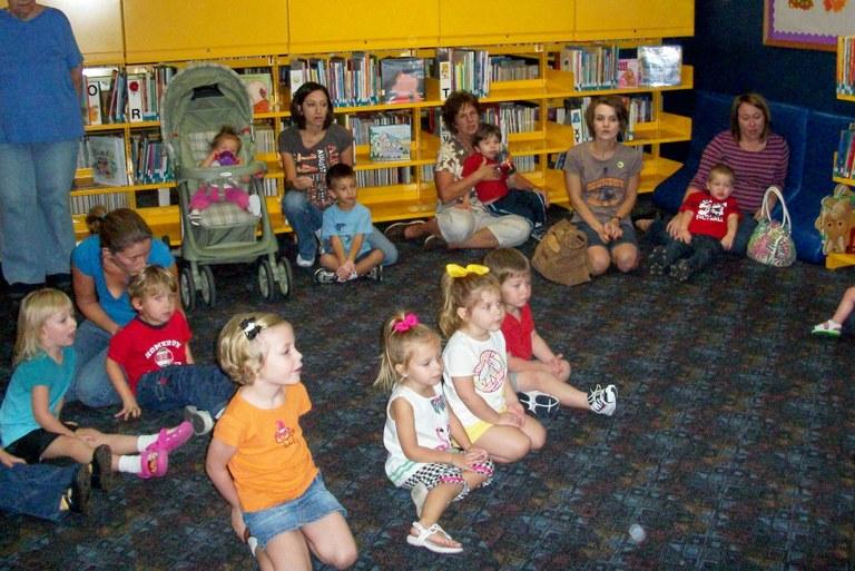 Cuddlebugs listening to story