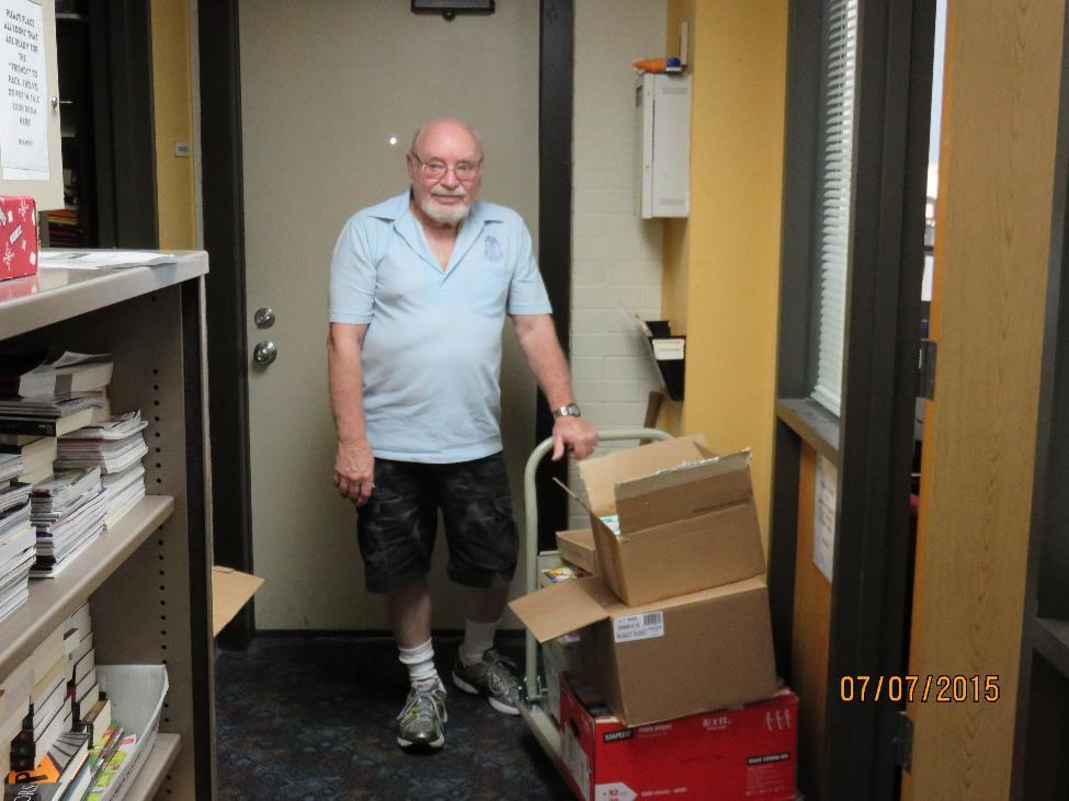 john rabalais with donations 2015.jpg