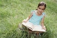 Little reader in grass